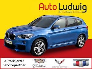 BMW X1 sDrive18i M Sport Aut. *NAVI *LEDER *LED *PANORAMA *PDC * bei AutoLudwig GMBH in 3x in 1230 Wien | US-Neuwagen (CADILLAC, CORVETTE, CHEVROLET, DODGE, RAM) | Multimarken Gebrauchtwagenhandel | KFZ Werkstatt mit Bosch Service